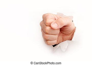 Breakthrough - Fist through a torn white paper - metaphor...