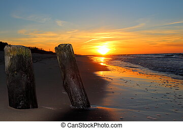 Breakwater and sunset on the beach