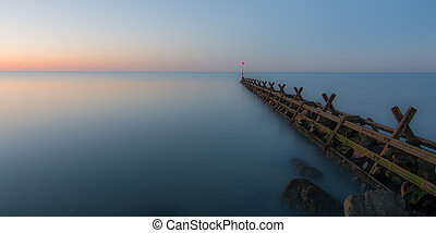 Breakwater at sunset