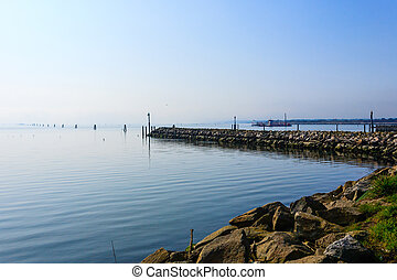Breakwater on adriatic sea. Goro port view. Po Delta...