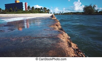 Breakwater on the coast of Cuba