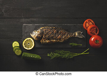 Bream fish with tomatoes, cucumbers and dill