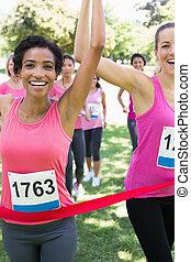 Breast cancer participants winning marathon race