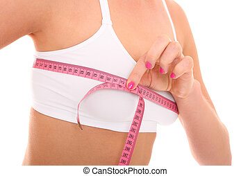 Breast size - A picture of a young fit happy woman checking...