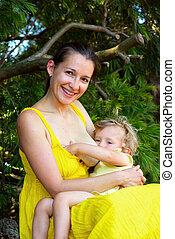 Breastfeeding - A beautiful photo of natural breastfeeding.