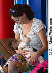 Breastfeeding in public - GOLD COAST - OCT 15 2014:Young...