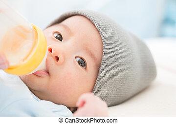 Breastfeeding, Mother feeding baby with milk bottle