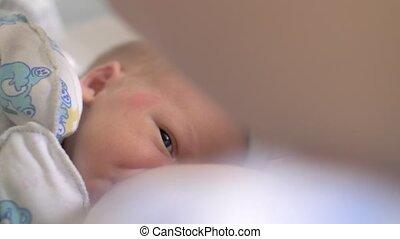 Breastfeeding newborn baby - Close-up shot of nursing...