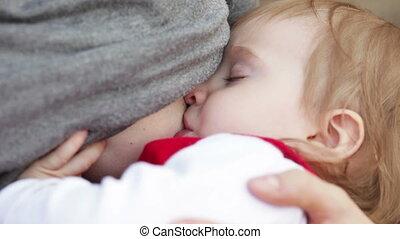 Breastfeeding sleeping child
