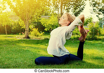 breathe - Beautiful young woman doing yoga stretching...