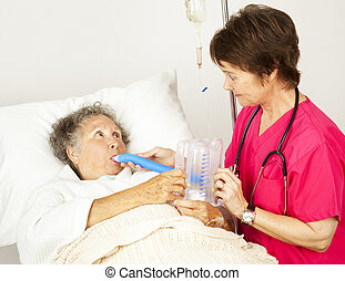 Breathing Exercise in Hospital - Nurse helps senior patient...