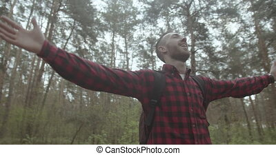 Breathing Healthy in Forest - Satisfied young bearded...