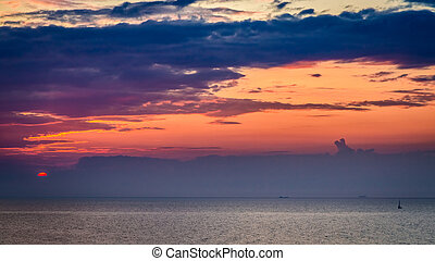 Breathtaking sunset over calm sea in summer