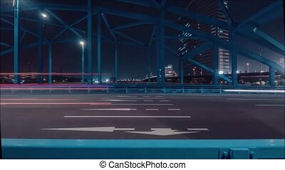 Breathtaking time lapse panorama view on huge steel highway road bridge across river in modern night city Tokyo downtown