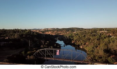 Breathtaking view of the arch bridge over the river in California