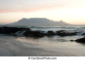 Rocks and waves with Table Mountain in the background