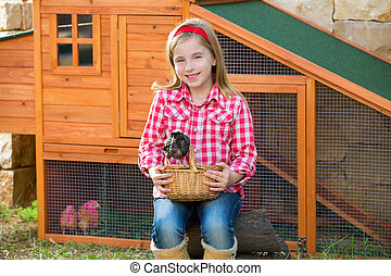 breeder hens kid girl rancher blond farmer playing with ...