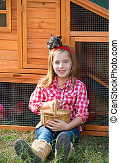 breeder hens kid girl rancher blond farmer playing with...