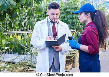 Breeder Talking to Worker in Farm