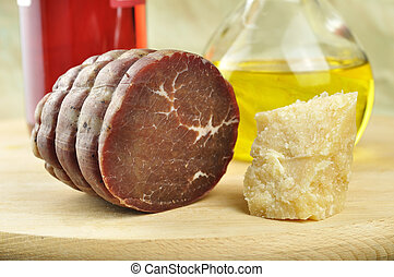 Bresaola of Valtellina, parmesan, olive oil and wine bottle...