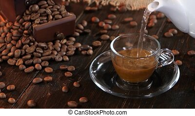 Brew instant black coffee in glass cup on a saucer - Brew...