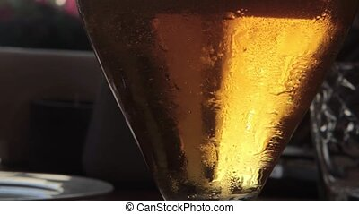 brewed Beer with bubbles In A Restaurant.
