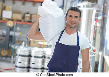 brewer carrying a bag of yeast