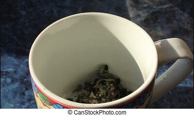Brewing motherwort herb - Shows the process of brewing with...