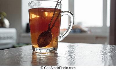Brewing tea in a cup closeup