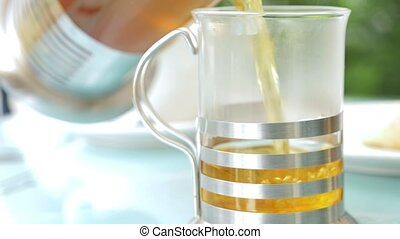 Brewing tea in a jug - Tea leaves floating in tea decoction....
