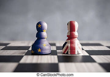 Two chess pawns with UK and European flags