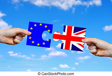 Brexit concept. Hands holding puzzle with flag of the UK and...
