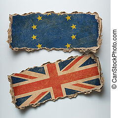 Brexit illustration. European union and Great Britain flags on cardboard.