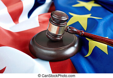 Gavel on top of British and European flags