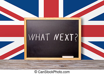 Brexit UK EU referendum concept for out of Great Britain from rest European union and handwriting text what next written in chalkboard with chalk on flag, close up