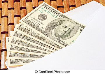 bribe of 100 dollar bills in an envelope