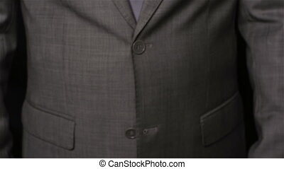 Bribe - Close-up of a businessman giving bundles of one...