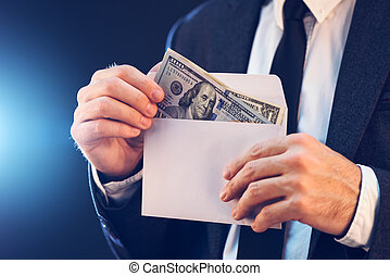 Bribery and corruption concept with cash money in envelope