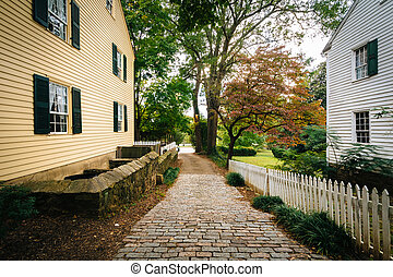 Brick alley and houses in Old Salem Historic District, in Winston-Salem, North Carolina.