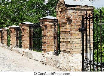 Brick and metal fence in Kiev Pechersk Lavra Monastery in Kiev, Ukraine