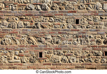 brick and stone medieval weathered wall textured background