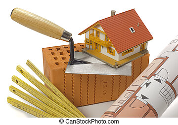 brick and tools for house building over white background