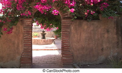 Brick Archway - Fountain seen through an arch in Mission San...