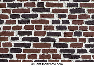 brick brown wall with white seams - background