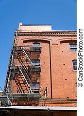 Brick Building Fire Escape - Fire escape running down the...