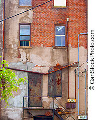 Brick Building - An old brick building with a window.