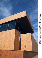 Brick Building - A modern brick building with a blue sky