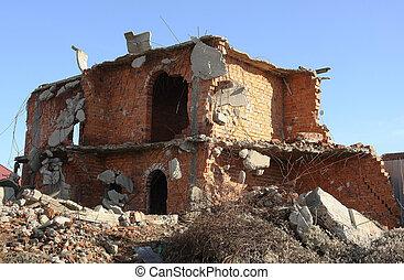 Brick building under demolition