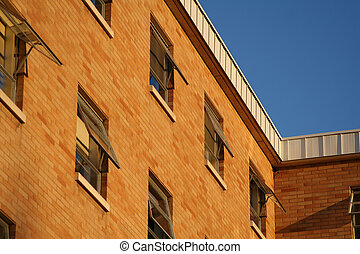 Brick building with open windows