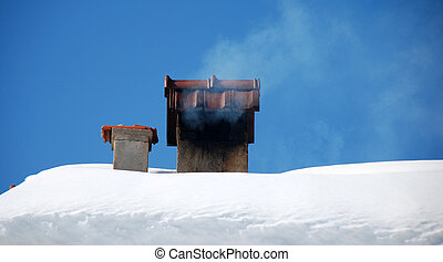 brick chimney in snow - brick chimney